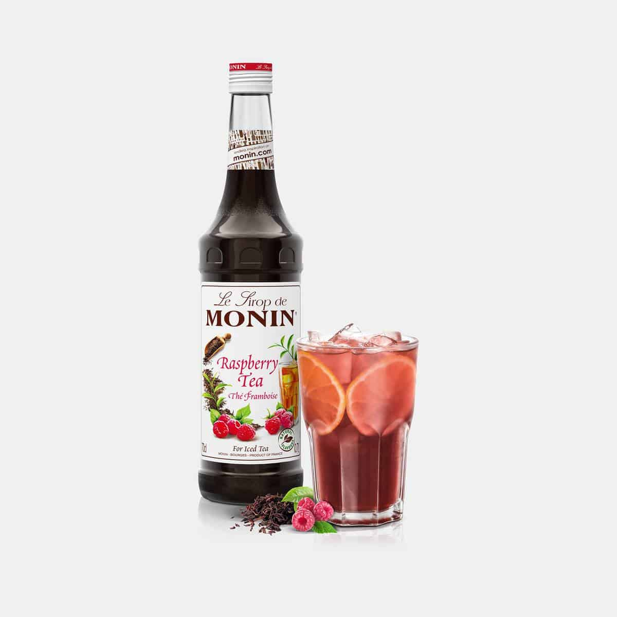 Monin 700ml Raspberry Tea Syrup Glass Bottle with Drink
